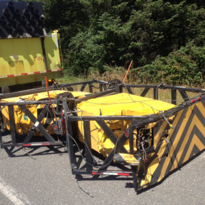 Damage to attenuator after highway truck accident